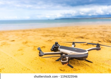 Penzance, Cornwall - England - 31st August 2018 - GoPro Karma drone ready to take off from a sandy beautiful beach