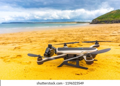 Penzance, Cornwall - England - 31st August 2018 - GoPro Karma drone ready to take off from a sandy beautiful beach, action camera and aerial drone