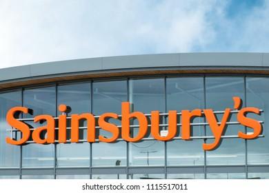 Penzance, UK - June 2018: Sainsbury's supermarket logo on a modern store facade