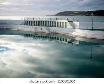 Penzance's art-deco Jubilee Pool in moody light, Cornwall, England, UK.