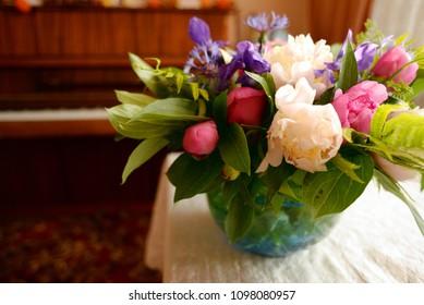 Peonies and fleur-de-lis in a vase