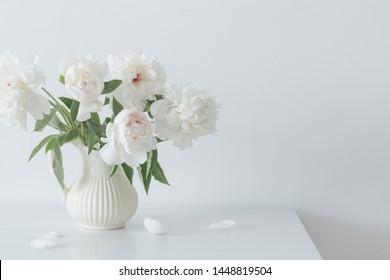 peonies flowers in vase on white background