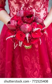 peonies & roses bouquet with red dress on background