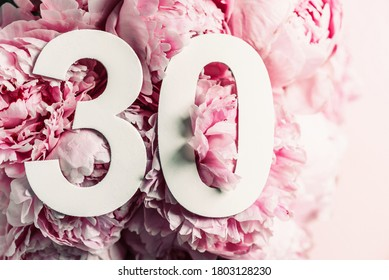 Peony flowers, digit thirty. Birthday greeting card with inscription 30. Anniversary concept. Top view. White numeral on flower background. Numerical digit, Celebration event, template, flyer.