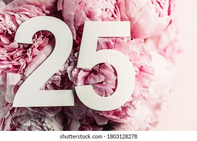 Peony flowers, digit twenty-five. Birthday greeting card with inscription 25. Anniversary concept. Top view. White numeral on flower background. Numerical digit, Celebration event, template, flyer.