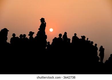 people against sunset