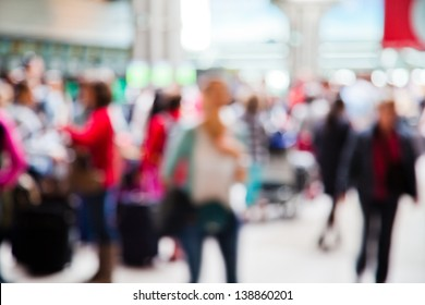 people at the airport in abstract out of focus blur