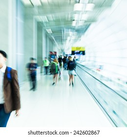people at the airport with creative zoom effect