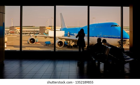 people in airport waiting for departure, silhouette of woman passenger traveling with luggage