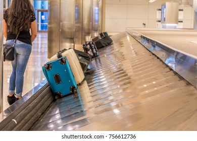 People at the airport waiting for their luggage at the baggage claim