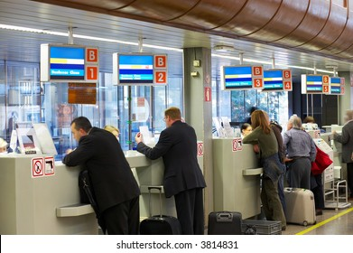 people at the airport's check-in