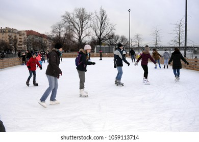People of all ages ice skating at an outdoor rink at January 02, 2018 in Budapest, Hungary.