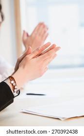 people applauding in a meeting, work, success