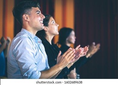 People applauding in the movie theater. Standing ovation.