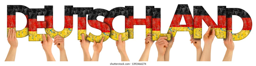 people arms hands holding up wooden letter lettring forming word Deutschland (english translation: Germany) in german national flag colors tourism travel nation concept isolated on white background