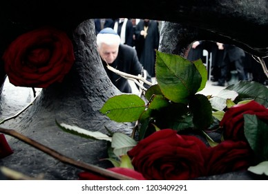 People attend a ceremony at the Holocaust Memorial commemorating the persecution of the Jewish people during World War II in Thessaloniki, Greece on Jan 29, 2012