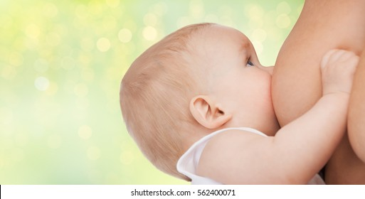 people, babyhood, nursing, lactation and children concept - close up of breastfeeding baby
