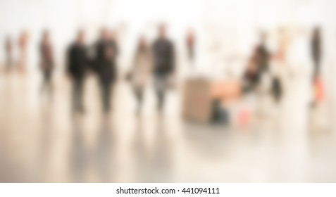 People background with an intentional blur effect applied. Humans not recognizable.