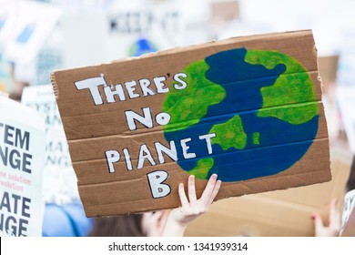 People with banners protest as part of a climate change march - Shutterstock ID 1341939314