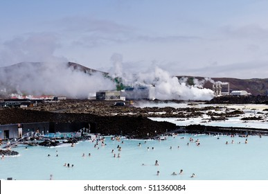 People bathing in the Blue Lagoon geothermal bath resort, Iceland. The geothermal power station in the background