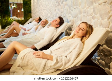 People in bathrobes are resting in the spa salon.