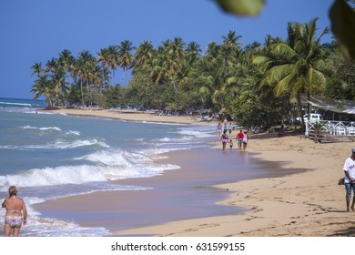 People at a beach, on a sunny day, in Las terrenas, Samana, Domenican republic