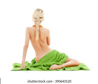 people, beauty, body care and spa concept - beautiful bare woman with green towel from back