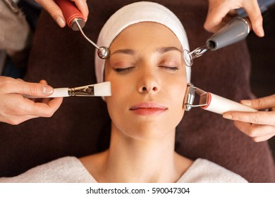 people, beauty, cosmetology and technology concept - beautiful young woman having needle free mesotherapy or hydradermie facial treatment in spa