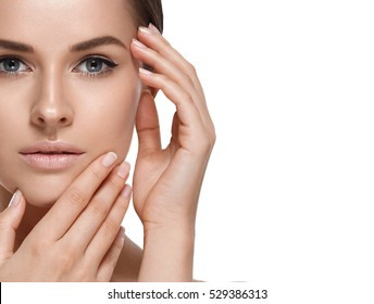 People, Beauty Woman face Portrait. Beautiful Spa model Girl with Perfect Fresh Clean Skin. Brunette female looking at camera and smiling. Youth and Skin Care Concept.