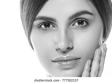 People, Beauty Woman face Portrait. Beautiful Spa model Girl with Perfect Fresh Clean Skin. Brunette female Youth and Skin Care Concept. Studio shot.