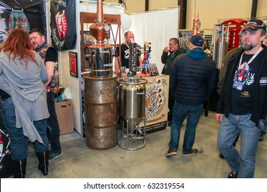 People at the beer mini bar. St. Petersburg Russia - 15 April, 2017. International Motor Show IMIS-2017 in Expoforurum. Visitors and participants of the annual moto-salon in St. Petersburg.
