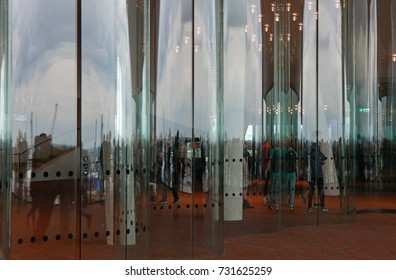 People behind undulating glass facade of the Elbphilharmonie building in Hamburg, Germany, on July 21, 2017