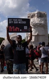 People with Black Lives Matter signs at The Freedom March, in Washington, DC on August 28, 2020