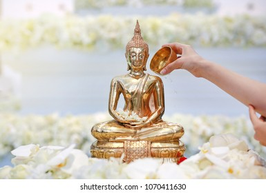 People blessing holy water and pay respects to Buddha statue on Songkran Festival or Thai New Year in the April month (Long holiday and summer seasons).