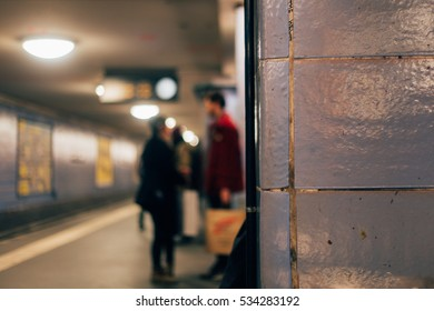 people blurred in a metro station, Berlin