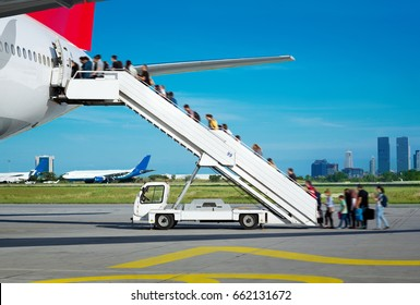 People boarding from apron