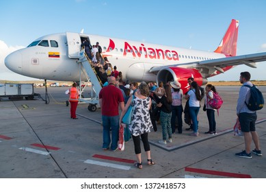 People boarding a plane airbus a319 Avianca airline at Queen Beatrix International Airport. Oranjestad.Aruba.24 February 2019.