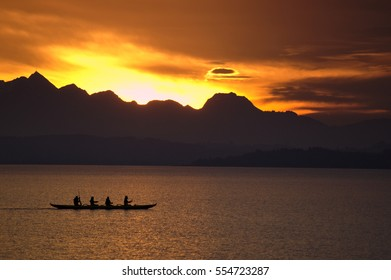 people in a boat rowing over the lake Chiemsee