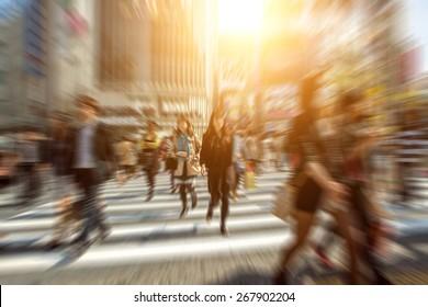 People in bokeh, street downtown view of  Tokyo.