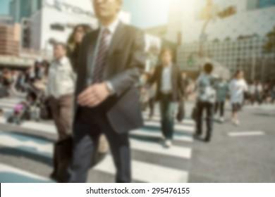 People in bokeh, street downtown view of  Tokyo. - Shutterstock ID 295476155