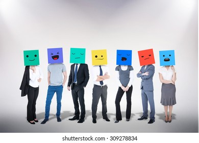 People with boxes on their heads against grey background