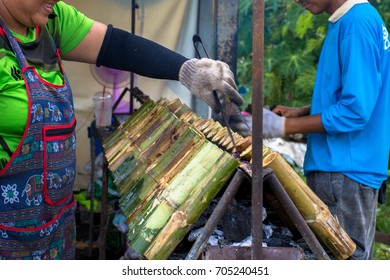 People burn glutinous rice roasted in bamboo joints