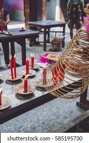 People burn spiral incense offering to God for luck in New Year at Chinese temple