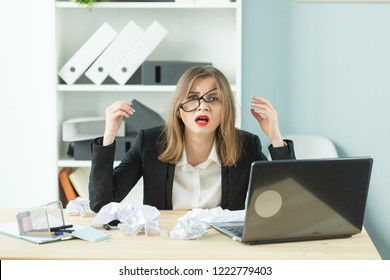 People, business and emotions concept - Woman with puzzled expression dressed in suit in office