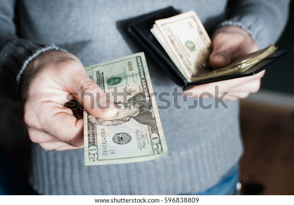 people, business, finances and money concept - close up of businessman hands holding open holding wallet