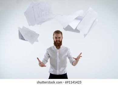 People, business, job, profession and occupation. Stressed pissed-off young bearded office worker in formal wear having furious look, throwing paper sheets up in the air after he failed project