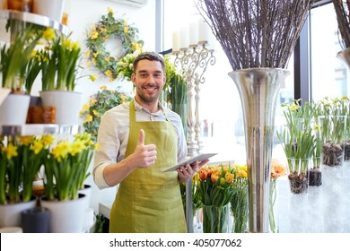 people, business, technology, sale and floristry and concept - happy smiling florist man with tablet pc computer at flower shop