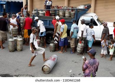 people buy Gas at the market the village of choroni on the caribbean coast in Venezuela.   Venezuela, Choroni, November, 2005