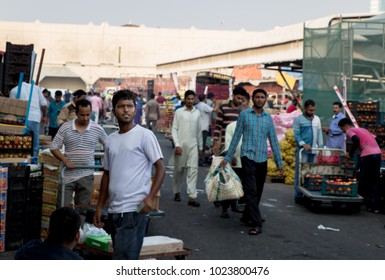 People buy and sell fruits and vegetables at the central market in Manama, Bahrain. June 1, 2017