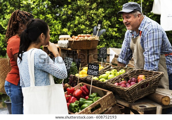 People Buying Fresh Local Vegetable From Farm at Market